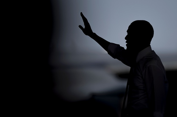 US president Barack Obama waves after speaking to service members at the Naval Station Rota, in Rota, southwestern Spain on July 10, 2016 Obama said he will cut short a foreign trip and visit Dallas next week as the shooting rampage by the black army veteran, who said he wanted to kill white cops, triggered urgent calls to mend troubled race relations in the United States. / AFP / JORGE GUERRERO (Photo credit should read JORGE GUERRERO/AFP/Getty Images)
