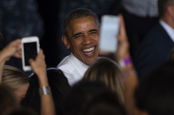 US president Barack Obama laughs after speaking to service members at the Naval Station Rota, in Rota, southwestern Spain on July 10, 2016 Obama said he will cut short a foreign trip and visit Dallas next week as the shooting rampage by the black army veteran, who said he wanted to kill white cops, triggered urgent calls to mend troubled race relations in the United States. / AFP / JORGE GUERRERO (Photo credit should read JORGE GUERRERO/AFP/Getty Images)