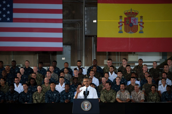 US president Barack Obama speaks to service members at the Naval Station Rota, in Rota, southwestern Spain on July 10, 2016 Obama said he will cut short a foreign trip and visit Dallas next week as the shooting rampage by the black army veteran, who said he wanted to kill white cops, triggered urgent calls to mend troubled race relations in the United States. / AFP / JORGE GUERRERO (Photo credit should read JORGE GUERRERO/AFP/Getty Images)