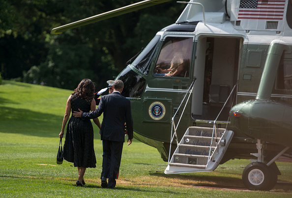 WASHINGTON, DC - JULY 12: First Lady Michelle Obama and President Barack Obama leave the White House and board Marine One on July 12, 2016 in Washington, DC. The Obamas are on their way to Dallas, Texas where the President will deliver remarks at an interfaith service at the Morton H. Meyerson Symphony Center with the families of the fallen police officers and members of the Dallas community. (Photo by Leigh Vogel/WireImage)