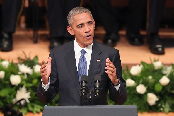 DALLAS, TX - JULY 12: U.S. President Barack Obama delivers remarks during an interfaith memorial service, honoring five slain police officers, at the Morton H. Meyerson Symphony Center on July 12, 2016 in Dallas, Texas. A sniper opend fire following a Black Lives Matter march in Dallas killing five police officers and injuring 12 others. (Photo by Tom Pennington/Getty Images)
