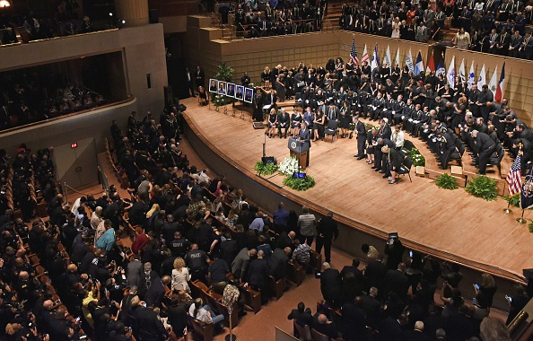 US President Barack Obama speaks during an interfaith memorial service for the victims of the Dallas police shooting at the Morton H. Meyerson Symphony Center on July 12, 2016 in Dallas, Texas. President Barack Obama attended a somber memorial Tuesday to five police officers slain in a sniper ambush in Dallas, as he seeks to unify a country divided by race and politics. / AFP / Mandel Ngan (Photo credit should read MANDEL NGAN/AFP/Getty Images)