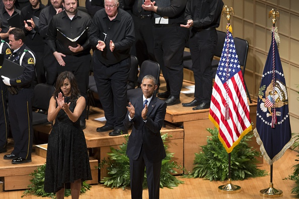 DALLAS, UNITED STATES - JULY 12: U.S. President Barack Obama and his wife Michelle Obama attend a memorial service for the victims of the Dallas police shooting at the Morton H. Meyerson Symphony Center in Dallas, Texas, USA on July 12, 2016. (Photo by Bilgin S. Sasmaz/Anadolu Agency/Getty Images)