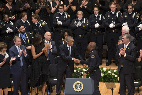 DALLAS, UNITED STATES - JULY 12: U.S. President Barack Obama shakes hands with Dallas Police Chief David Brown during a memorial service for the victims of the Dallas police shooting at the Morton H. Meyerson Symphony Center in Dallas, Texas, USA on July 12, 2016. (Photo by Bilgin S. Sasmaz/Anadolu Agency/Getty Images)