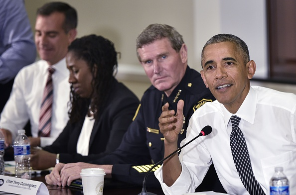 US President Barack Obama speaks during a discussion on community policing and criminal justice in the Eisenhower Executive Office Building, next to the White House, on July 13, 2016 in Washington, DC. From left are: Los Angeles Mayor Eric Garcetti; President and Director-Counsel of the NAACP Legal Defense and Educational Fund Sherrilyn Ifill; Chief Terry Cuningham of the International Association of Chiefs of Police; President Obama. / AFP / MANDEL NGAN (Photo credit should read MANDEL NGAN/AFP/Getty Images)