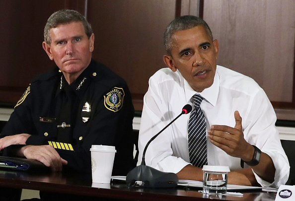 "WASHINGTON, DC - JULY 13: U.S. President Barack Obama (R) speaks as Terry Cunningham (L) of International Association of Chiefs of Police listens during a conversation on community policing and criminal justice July 13, 2016 at Eisenhower Executive Office Building in Washington, DC. President Obama hosted a conversation with activists, civil rights, faith, law enforcement and elected leaders from around the country on ways can ""keep people safe, build community trust, and ensure justice for all Americans."" (Photo by Alex Wong/Getty Images)"