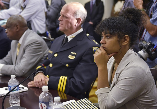 Black Lives Matter activist Mica Grimm (R) listens beside New Haven Police Chief Dean Esserman (L) during a discussion on community policing and criminal justice at the Eisenhower Executive Office Building, next to the White House, on July 13, 2016 in Washington, DC. / AFP / MANDEL NGAN (Photo credit should read MANDEL NGAN/AFP/Getty Images)