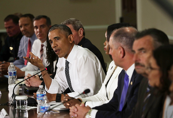 "WASHINGTON, DC - JULY 13: U.S. President Barack Obama (C) speaks during a conversation on community policing and criminal justice July 13, 2016 at Eisenhower Executive Office Building in Washington, DC. President Obama hosted a conversation with activists, civil rights, faith, law enforcement and elected leaders from around the country on ways can ""keep people safe, build community trust, and ensure justice for all Americans."" (Photo by Alex Wong/Getty Images)"