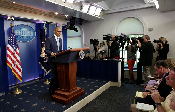 """US President Barack Obama makes a statement at the White House in Washington about police officers deadly shooting in Baton Rouge on July 17, 2016. Obama condemned as """"cowardly"""" a shooting that killed three police officers and wounded three more in the Louisiana capital of Baton Rouge on Sunday. / AFP / YURI GRIPAS (Photo credit should read YURI GRIPAS/AFP/Getty Images)"""