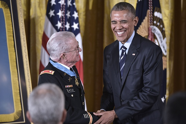 US President Barack Obama shakes hands with retired US Army Lt. Colonel Charles Kettles after presenting him with the Medal of Homor during a ceremony in the East Room of the White House on July 18, 2016 in Washington, DC. Lt. Colonel Kettles was awarded the Medal of Honor for conspicuous gallantry while serving in Vietnam. / AFP / MANDEL NGAN (Photo credit should read MANDEL NGAN/AFP/Getty Images)