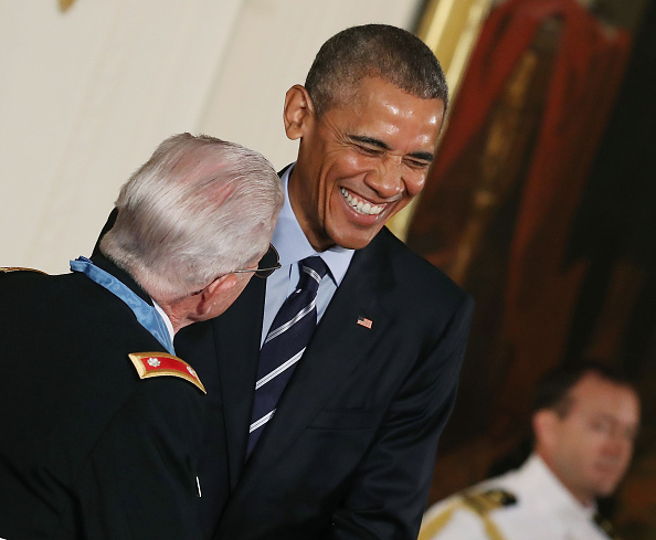 WASHINGTON, DC - JULY 18: U.S. President Barack Obama shares a laugh with retired Army Lt. Col. Charles Kettles, after presenting him with the Medal Of Honor during a ceremony in the East Room at the White House July 18, 2016 in Washington, DC. Kettles who was a UH-1D Huey helicopter pilot during the Vietnam War displayed extraordinary heroism, and is credited with saving the lives of 40 soldiers and four of his own crew members. (Photo by Mark Wilson/Getty Images)