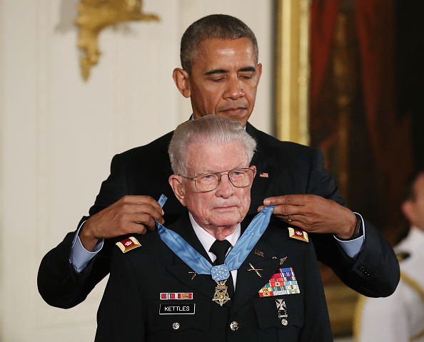 WASHINGTON, DC - JULY 18: U.S. President Barack Obama presents the Medal of Honor to retired Army Lt. Col. Charles Kettles, during a ceremony in the East Room at the White House July 18, 2016 in Washington, DC. Kettles who was a UH-1D Huey helicopter pilot during the Vietnam War displayed extraordinary heroism, and is credited with saving the lives of 40 soldiers and four of his own crew members. (Photo by Mark Wilson/Getty Images)
