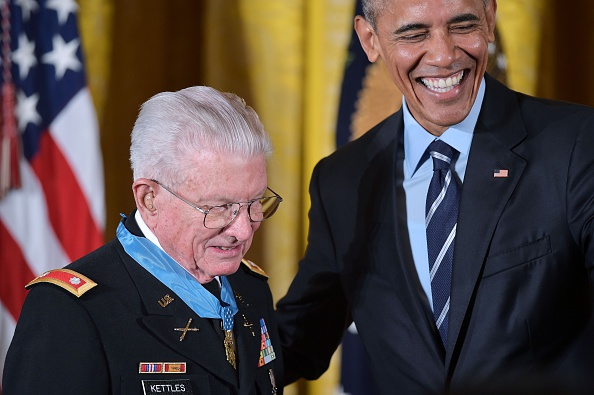 US President Barack Obama stands with retired US Army Lt. Colonel Charles Kettles after presenting him with the Medal of Homor during a ceremony in the East Room of the White House on July 18, 2016 in Washington, DC. Lt. Colonel Kettles was awarded the Medal of Honor for conspicuous gallantry while serving in Vietnam. / AFP / MANDEL NGAN (Photo credit should read MANDEL NGAN/AFP/Getty Images)