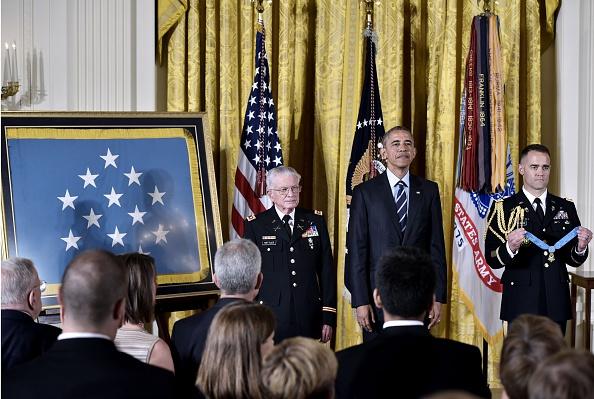 US President Barack Obama and retired US Army Lt. Colonel Charles Kettles(L) listen as the citation is read during a presents the Medal of Honor ceremony in the East Room of the White House on July 18, 2016 in Washington, DC. Lt. Colonel Kettles was awarded the Medal of Honor for conspicuous gallantry while serving in Vietnam. / AFP / MANDEL NGAN (Photo credit should read MANDEL NGAN/AFP/Getty Images)