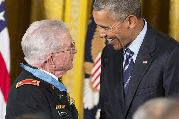 Vietnam War veteran Army Lieutenant Colonel Charles Kettles speaks with U.S. President Barack Obama after he was presented with the Medal of Honor at the White House in Washington, D.C., U.S., on Monday, July 18, 2016. Kettles led helicopter flights carrying reinforcements to U.S. soldiers and is credited with helping to save 40 soldiers and four members of his unit. Photographer: Joshua Roberts/Bloomberg via Getty Images