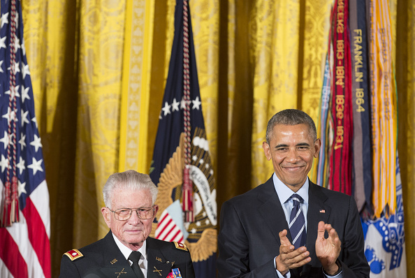 U.S. President Barack Obama applauds retired Army Lieutenant Colonel Charles Kettles during a Medal of Honor ceremony for the Vietnam War veteran at the White House in Washington, D.C., U.S., on Monday, July 18, 2016. Kettles led helicopter flights carrying reinforcements to U.S. soldiers and is credited with helping to save 40 soldiers and four members of his unit. Photographer: Joshua Roberts/Bloomberg via Getty Images
