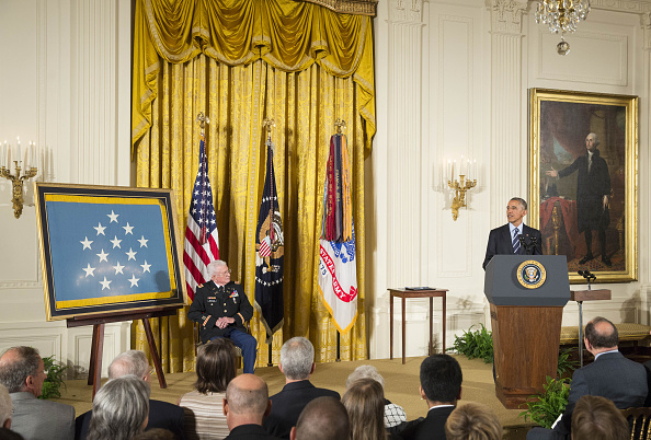 U.S. President Barack Obama addresses retired Army Lieutenant Colonel Charles Kettles during a Medal of Honor ceremony for the Vietnam War veteran at the White House in Washington, D.C., U.S., on Monday, July 18, 2016. Kettles led helicopter flights carrying reinforcements to U.S. soldiers and is credited with helping to save 40 soldiers and four members of his unit. Photographer: Joshua Roberts/Bloomberg via Getty Images