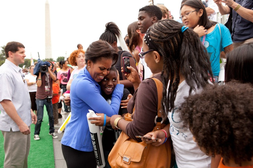 First Lady Michelle Obama greets children in audience of the obstacle course during the National Day of Play on the Ellipse outside the White House in Washington, DC Sept. 24, 2011. (Official White House Photo by Chuck Kennedy)