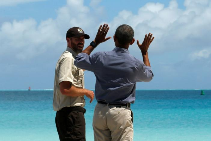 U.S. Marine National Monuments Superintendent Matt Brown (L) gives President Barack Obama at tour of the Papahanaumokuakea Marine National Monument, Midway Atoll, U.S. September 1, 2016. REUTERS/Jonathan Ernst