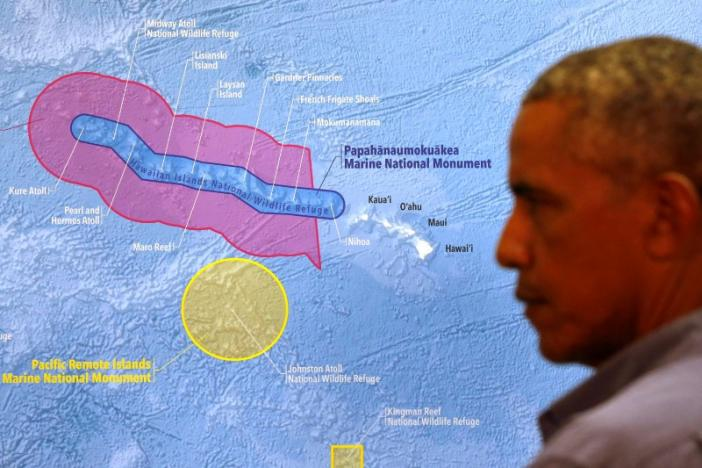 U.S. President Barack Obama views a map prior to a tour of Papahanaumokuakea Marine National Monument on Midway Atoll, U.S. September 1, 2016. REUTERS/Jonathan Ernst