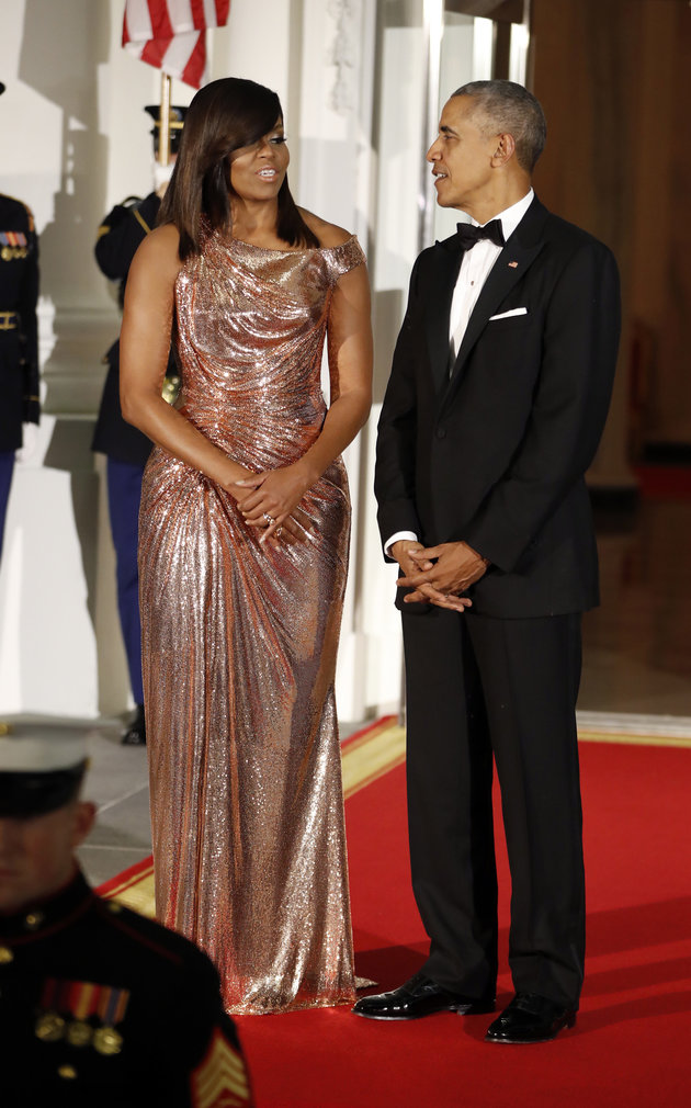President Barack Obama and first lady Michelle Obama wait to greet Italian Prime Minister Matteo Renzi and his wife Agnese Landini on the North Portico for a State Dinner at the White House in Washington, Tuesday, Oct. 18, 2016. (AP Photo/Pablo Martinez Monsivais)
